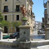 Located in Piazza del Popolo, the fountain was realized in 1889 by the Engineer Luigi De Seta. The octagonal stone basin is completed with four drinking troughs, decorated with several heads of birds of pray. In the middle, on the top of...