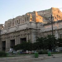 The first stone was laid by King Vittorio Emanuele III in 1906, at the inauguration of the Universal Exhibition. Six years after it was launched a new competition for a project inspired by the stations in Leipzig and Stuttgart: a covered...