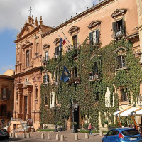 It was built in 1627 as Tomasi di Lampedusa family residence.ThanConvent of Dominicans and, since 1867,Town Hall. Ithas an ironportal and a series of ornamental windows and balconies making itcompact and...